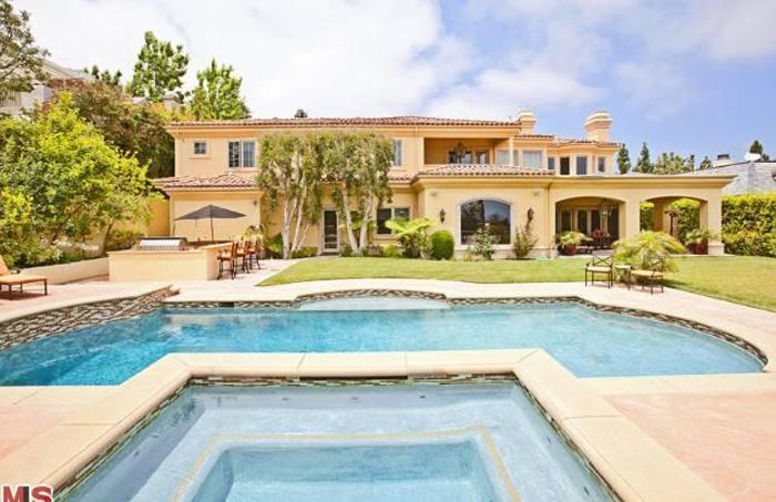 Denise Richards has moved in to a home that Charlie Sheen purchased for her in the Mulholland Estates (Los Angeles).