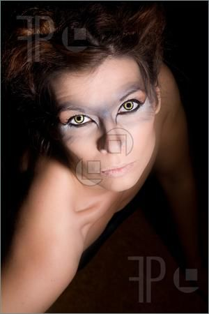 Picture Of Beautiful Woman With Wolf Eyes Looking Up From ...