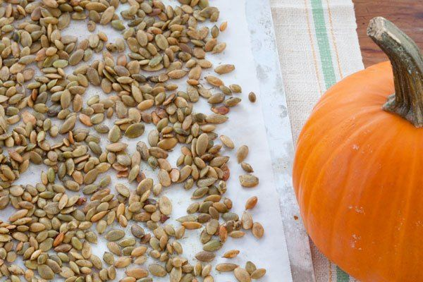 5 Ways to Cook & Eat Pumpkin Seeds | Just finished carving your #Halloween decorations and don't want to let those perfectly good #pumpkinseeds go to waste? Here's how to salvage the seeds and cook them in five different ways. | SouthernLiving.com