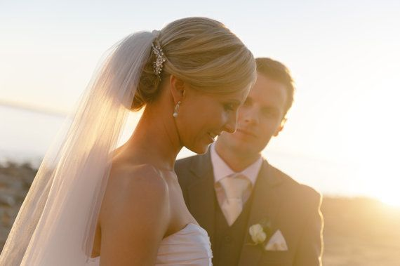 Style of hair that I want.  Veil on top of pulled back hair with small crystal comb