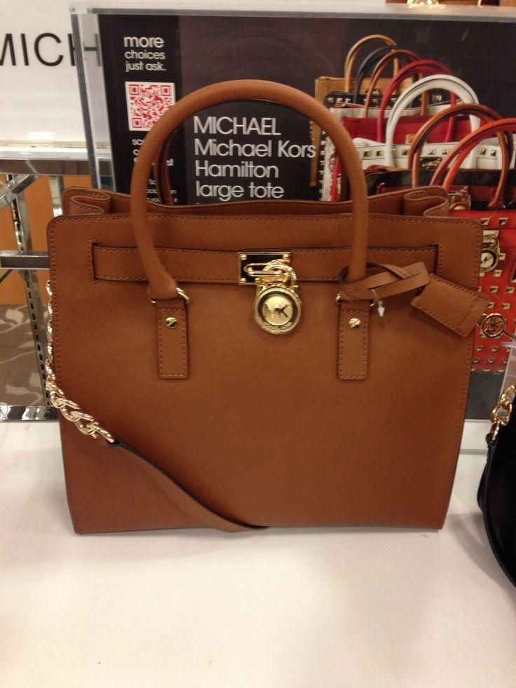 Celebrate great American fashion with the gorgeous handbag from Michael Kors. Features all over MK logo exterior with leather belt straps, gold MK medallion on leather cord, and two large open side pockets.