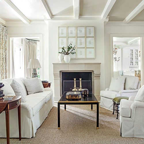 white, interiors, design, style, Suzanne Kasler, Southern Living - framed intaglios on piano hinges hide tv