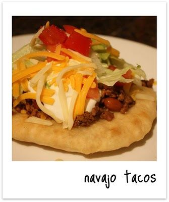 Navajo Tacos:  1 pound ground beef*1 (1.25 ounce) package taco seasoning*mix*1 (15.5 ounce) can pinto beans, with liquid*1 cup shredded Cheddar cheese*2 cups shredded iceberg lettuce*1/2 cup picante sauce  FRY BREAD:  2 cups all-purpose flour*1 tablespoon baking powder*1 teaspoon salt*1 cup milk*4 cups oil for frying, or as needed