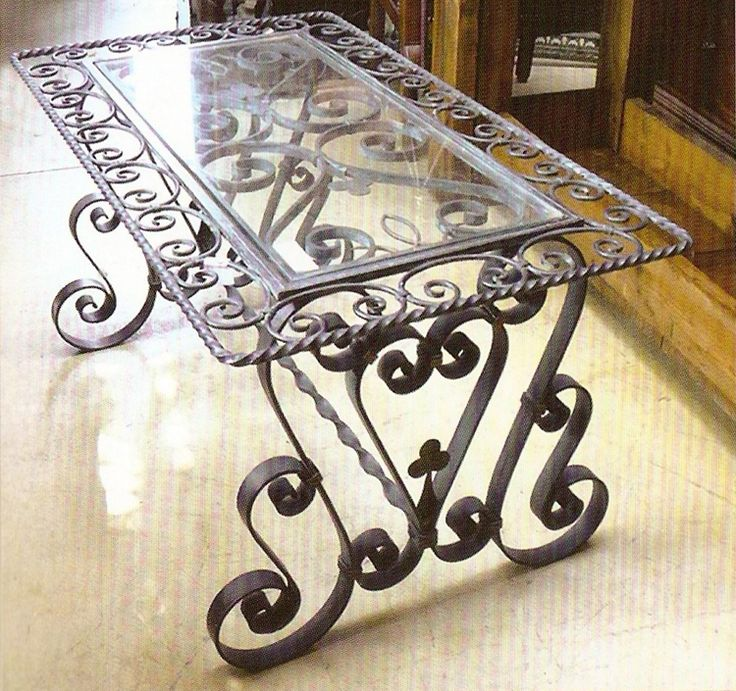 Very old world in style.  Visit stonecountyironworks.com for more beautiful wrought iron designs!
