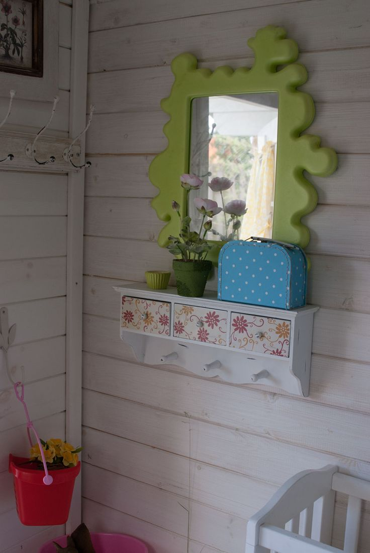 Inside of playhouse. Shelf painted White and drawers covered with wallpaper. See more at www.evabyeva.dk