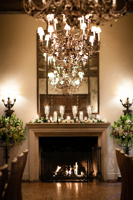 Wood-beamed ceiling, fireplace, and wrought iron chandeliers in El Mar.    Rebecca & Martin   Four Seasons Biltmore Santa Barbara Wedding