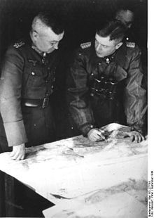 "Wehrmacht Field Marshal Walter Model - ""The Lion of Defence""/""Firefighter of the Eastern front"" - going over maps for a tactical purpose"