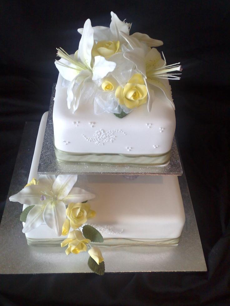Two Tier wedding cake on Pillars