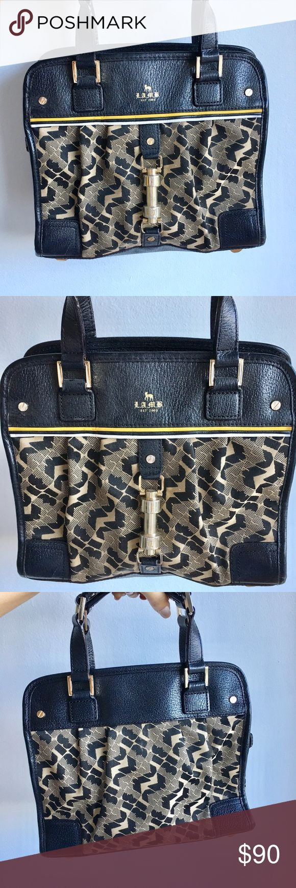 LAMB handbag This LAMB handbag has been one of my all time favs. It's gently used and in great condition. Trimmed with genuine black leather with gold hardware and one of the LAMB signature patterns on the body. The interior has a ton of pockets as well. This bag is much more spacious than it looks FYI. 😊💫💼 LAMB Bags