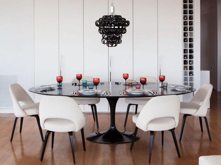 Овальные столы для кухни: тонкости выбора и 80+ комфортных моделей для современного интерьера http://happymodern.ru/ovalnye-stoly-dlya-kuxni/ Черный овальный кухонный стол со скругленной столешницей
