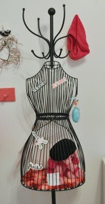 Paris themed bedroom make with bungee cords to put stuffiess in