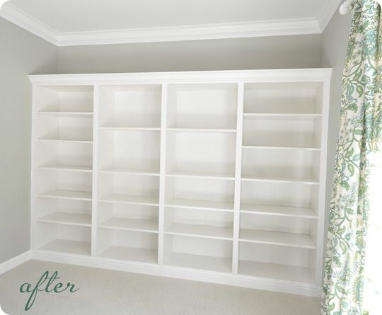 ikea bookshelves - $69 ea. - combine 4 & do crown moulding on top... voila! looks like built-ins! This will be done in the basement!