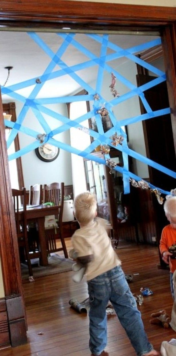 Spider web game. Just use painters tape to make the web and have the kids throw wads of paper at it to see if they can get it to stick
