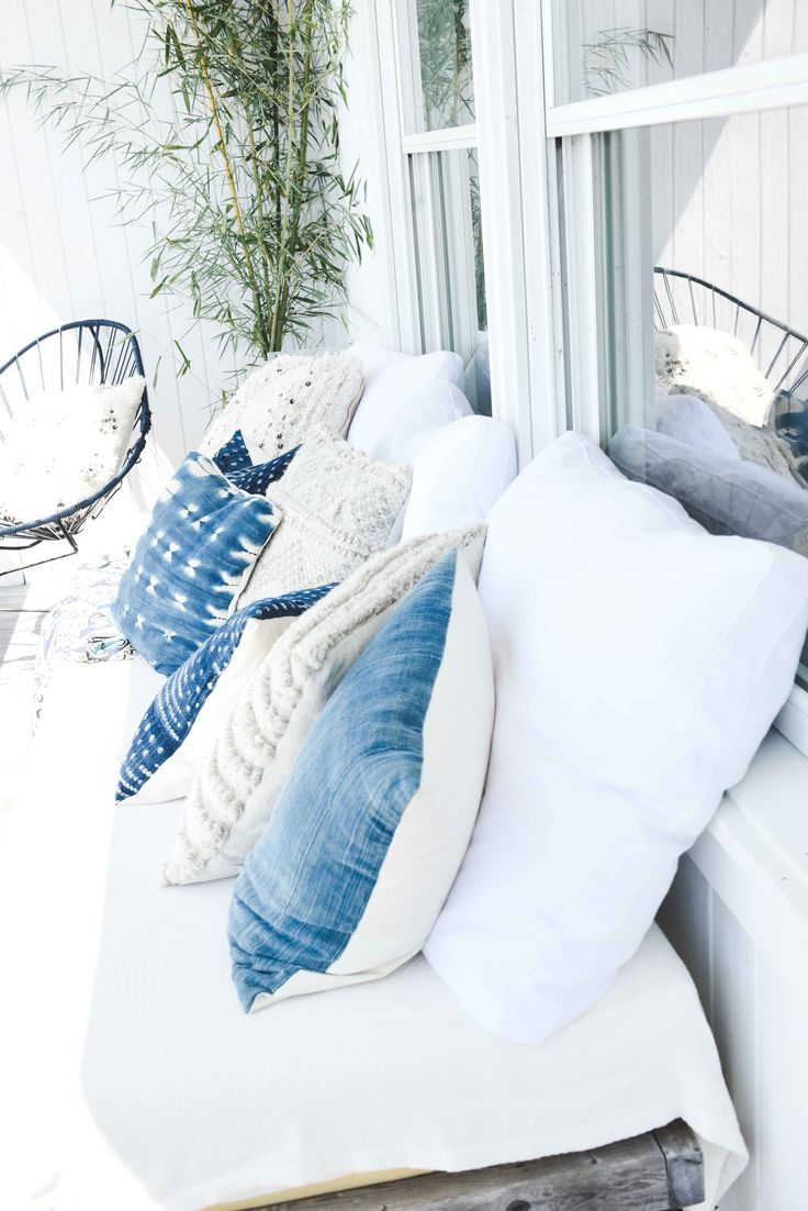 the coziest, dreamiest oceanfront couch - complete with ivory crochet & hand-dyed indigo pillows || Billabong's Summer Surf Party