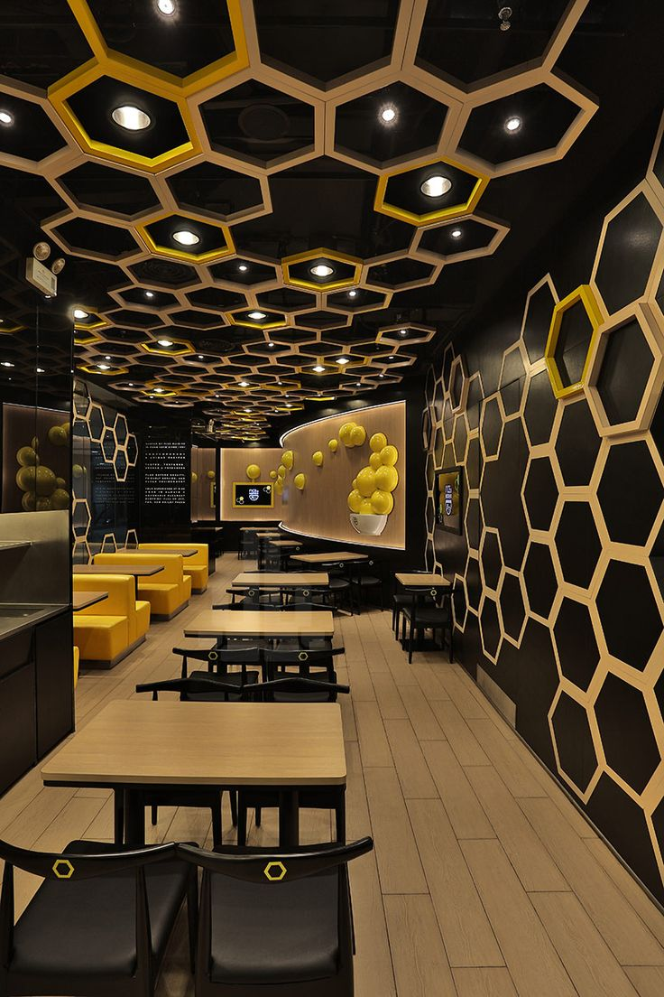 Irregular hexagons are distributed throughout the 'rice home' restaurant located in guangzhou city, china by hong kong company AS design. a dynamic interior reflects the newly launched casual dining brand that emphasizes on unique and contemporary recipes that are creatively blended with modern and innovative approach.