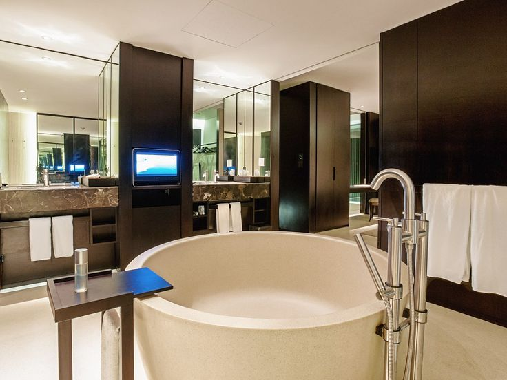 Oversized bathroom with bath and hand showers