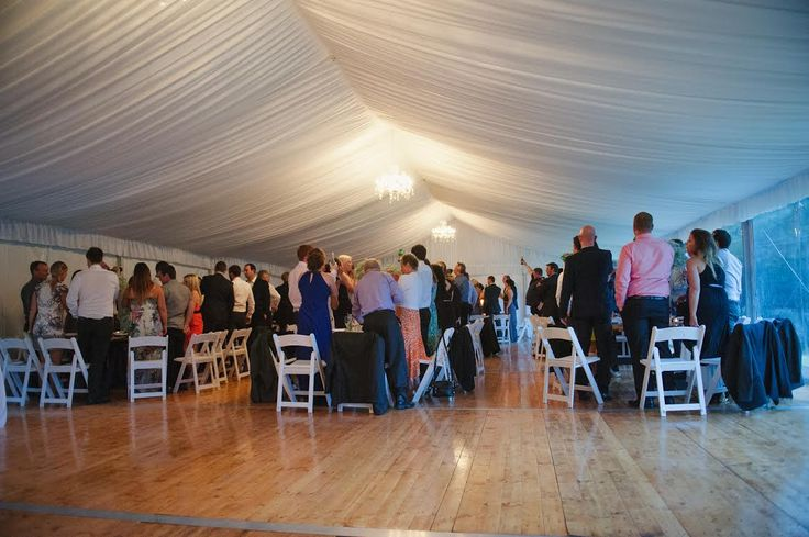chandeliers, silk lining, integrated timber flooring, white padded folding chairs, marquee weddings, south coast party hire