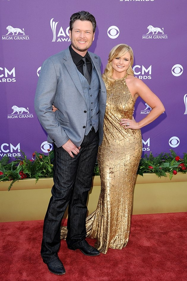 "One of the evening's co-hosts, ""The Voice"" coach Blake Shelton, looked dapper in gray and black when he arrived with his wife, fellow country musician Miranda Lambert, who donned a dress that reminded us of Stacy Keibler's Oscars gown."