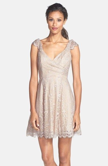 Sweet lace bridesmaids dress with a v neck cap sleeves and scooped back