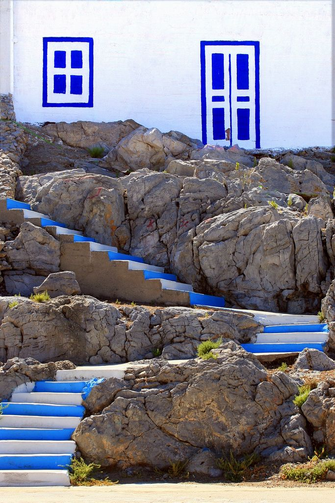 Painted wall n stairs in Pserimos harbour, Pserimos island, Dodecanese_ Greece