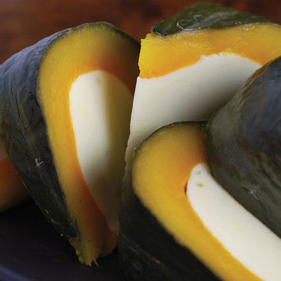 This coconut custard is cooked directly inside a hollowed-out pumpkin, ready to…