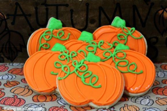 How to make and decorate these adorable pumpkin sugar cookies. Your family will love these iced sugar cookies. Easy to make pumpkin roll out sugar cookies