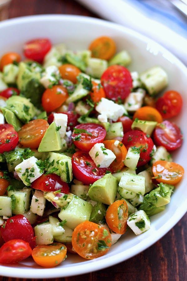 Cucumber Tomato Avocado Healthy Salad: 1 avocado - diced 4 oz feta cheese - cubed 2 tbs minced red onion 2 tbs olive oil 1 tbs red wine vinegar 8 twists of black pepper from a pepper mill 1½ cups of chopped tomatoes 1 cucumber