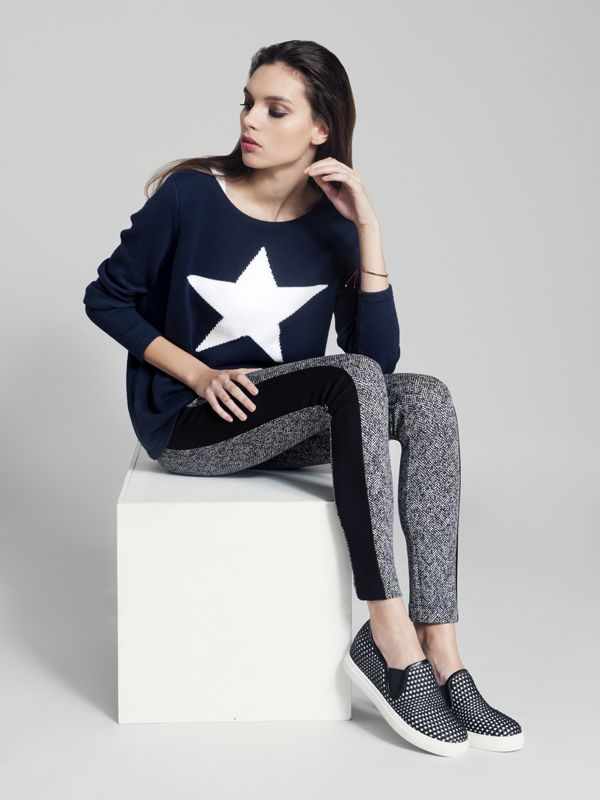 We love this graphic knit teamed with printed leggings.