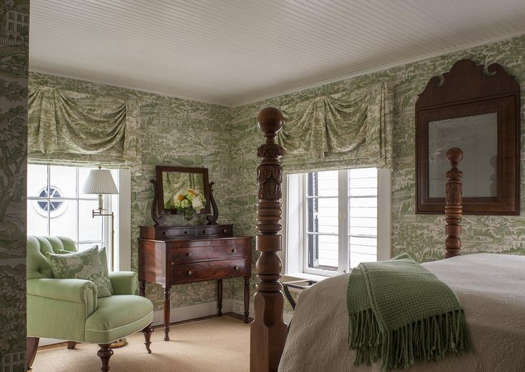 Peaceful and serine room with green twall wallpaper and antique wood  furniture. SLC INTERIORS -