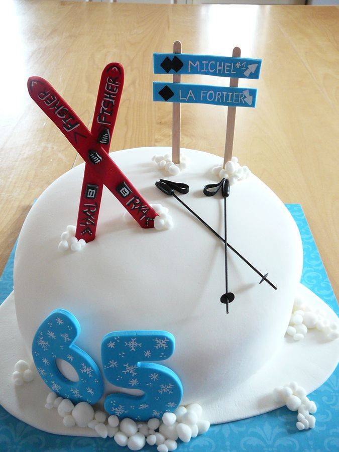 A vanilla cake with strawberry jam and buttercream covered with fondant for a huge ski fan! All edible except for the wood sticks that hold ...