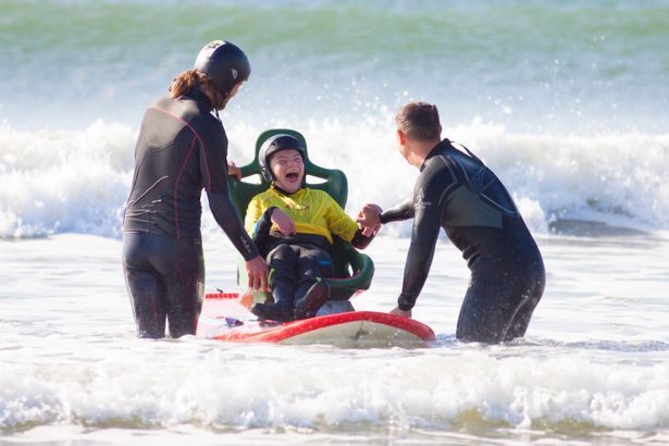 Kai Lewis, 13 was left laughing with joy as he tested a new board to let wheelchair-bound children to safely surf