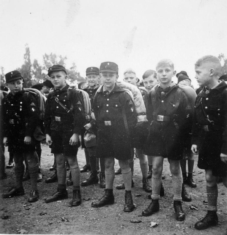 Junior members of the Hitler Youth prepare for a route march.