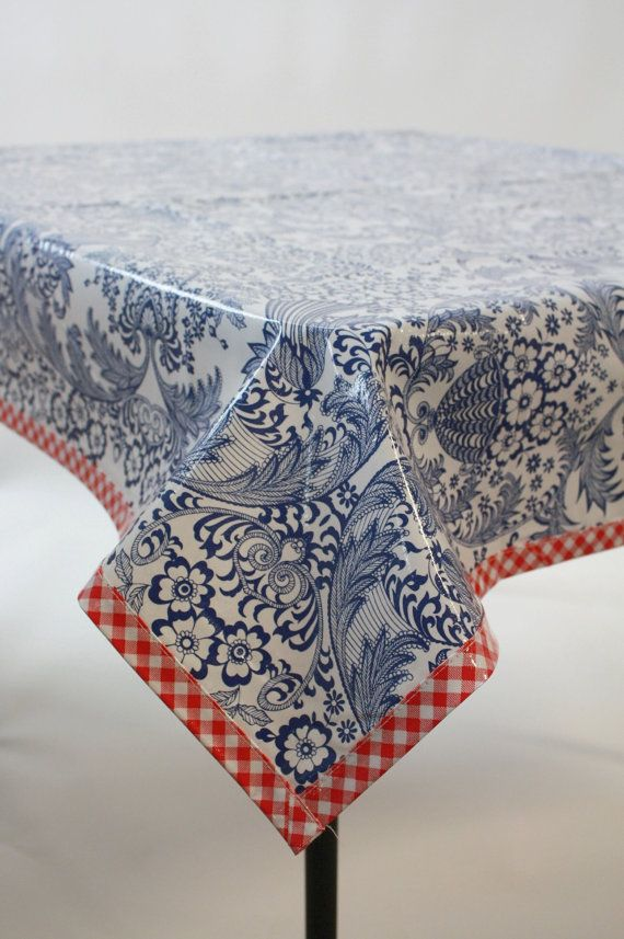 Toile print in navy blue with a red gingham trim! Perfect for indoors or out - in your kitchen, dining room, patio, picnic table, pool area, or garden. Take to your beach house or give as a gift!  Simply wipe Clean  Handmade in Philadelphia!  In stock and ready to ship! On sizes over 48 wide, we add the fabric to the width - no worries, no seams down the middle, we french seam it down the sides