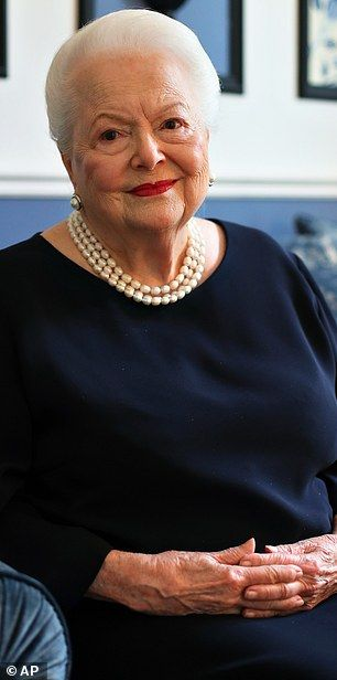 Still so glamourous: Olivia de Havilland, the picture of elegance in Paris on June 18, turns 100 on Friday