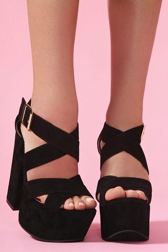 Shadow Platform. This is making it on my to buy list. #nastygal #blackplatforms #heels