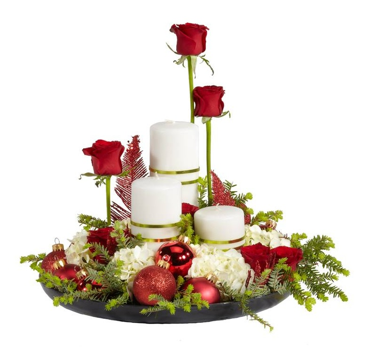 Christmas Centerpiece from candles, flowers, ornaments, and evergreen clippings