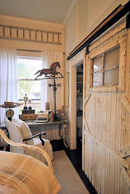 That Laurie Anna, she took an old barn door and added hardware to make it a sliding door to divide the small guest room from the adjoining bath.