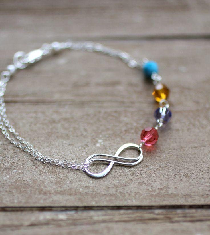 Mother's Bracelet, Infinity Bracelet, Custom Birthstones, Grandmother's Bracelet, Four crystal birthstones, Custom Bracelet, Sterling Silver. $42.00, via Etsy.