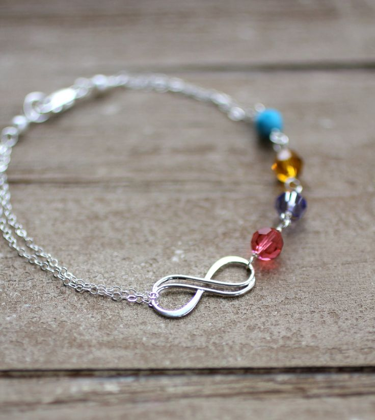Mother's Bracelet, Infinity Bracelet, Custom Birthstones, Grandmother's Bracelet, Four crystal birthstones, Custom Bracelet, Sterling Silver. $42.00, via Etsy.