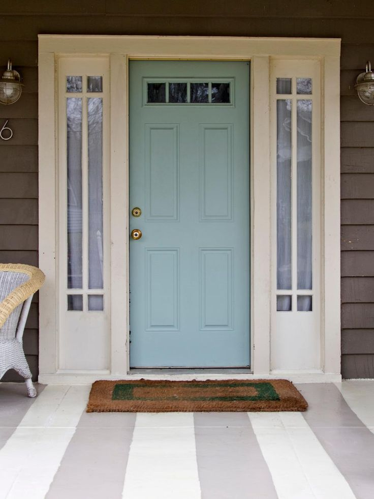 "Blogger Ellen Mallernee Barnes (blackandwhiteandlovedallover.com) got so inspired while she was painting her front door blue — that's Benjamin Moore's Wythe Blue — that she decided to go all out with porch stripes. Those colors are from Sherwin-Williams: Perfect Greige and Antique Ivory. ""It turned out so fun and bright,"" Barnes says. ""I love pulling into my driveway now."""