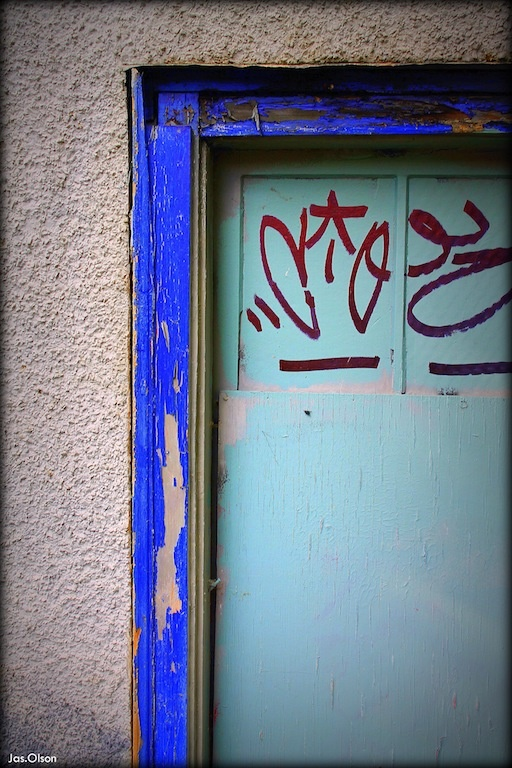Boarded up home w/ graffiti on The Drive- Commercial Drive, Vancouver, that is. circa 2012