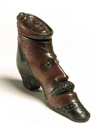 Victorian snuff box shaped like a shoe with a man's face. England, c. 1860.: