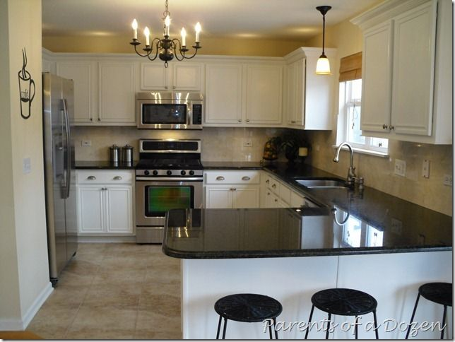 white cabinets, SST appliances, black counter top? , matching drop lights over sink & bb bar.