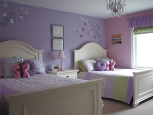 Girl's room with two beds. Pink and Purple with butterflies