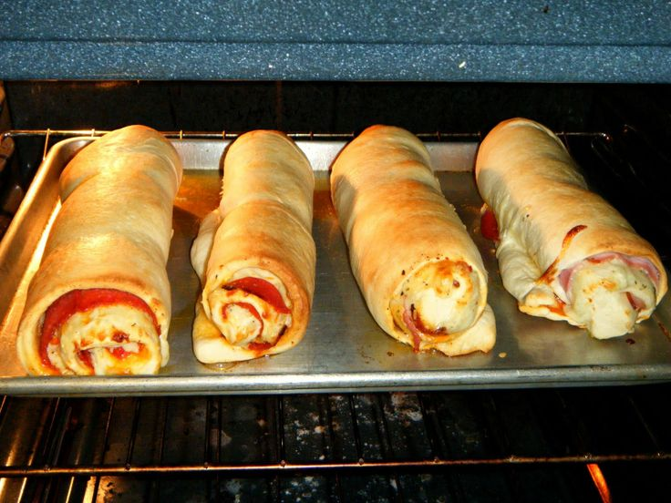 A friends mom used to serve these whenever we popped into her house. So good!: Pepperoni Rolls