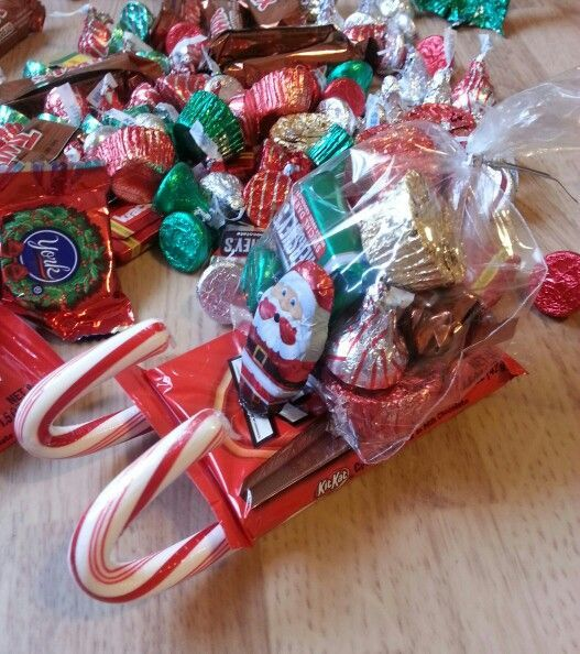 you need a hot glue gun, sticks, bags and kit kats with candy canes and whatever candy you would like to put in santas bag