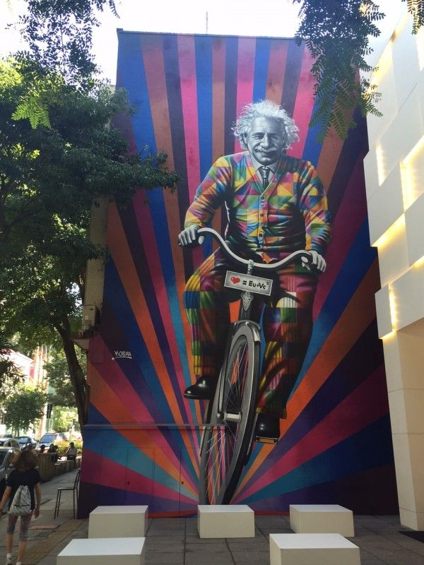 "Brazilian street artist Eduardo Kobra has delivered a new wall in São Paulo, Brazil. The wall, entitled as ""Genial is riding a bike"", is 13 meters high by 7 meters large and the painting shows Albert Einstein riding a bicycle."