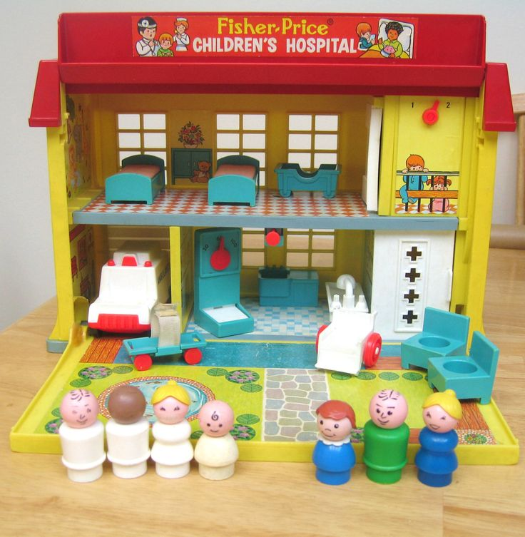 Vintage Fisher Price Hospital. amy had this one. My fav part was the little gurney that had a velcro strap that would hold the person down.
