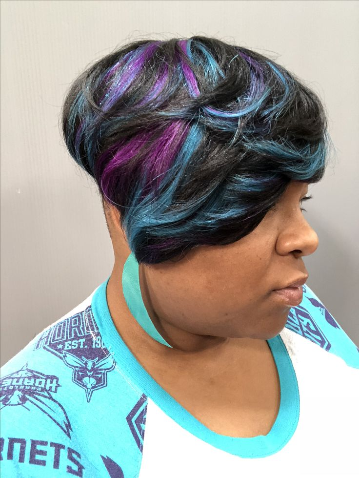 Short hair style with shaved sides, purple and turquoise highlights