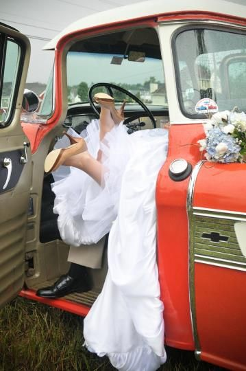 Cute photo of bride and groom feet out of the getaway car by dani. fine photography  northampton, massachusetts